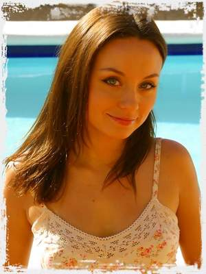 Carla outside in the sun wearing a sexy minidress