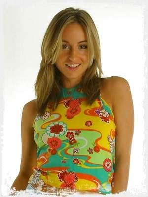 Melanie in a bright tight top and denim miniskirt.