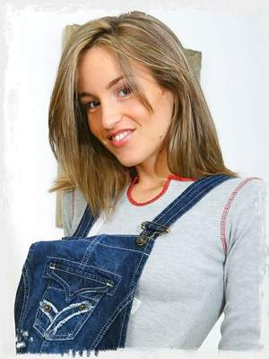 Melanie in a cute denim dungaree minidress and thick woolen pantyhose.