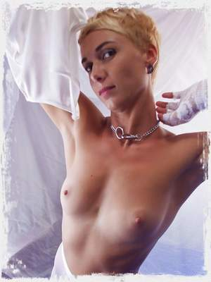 Lindra sensually poses in front of the camera as she displays her tight body and yummy pussy.