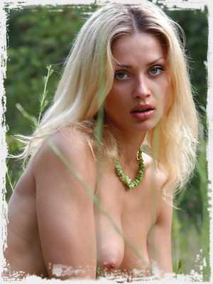 Hot and young blonde gets naked in the forest.