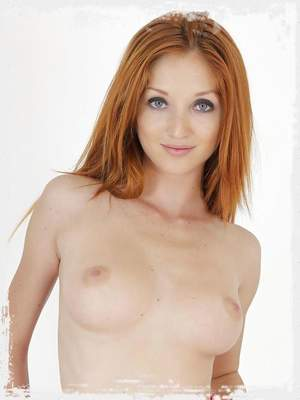 Gorgeous redhead Michelle opens her pussy lips for your pleasure