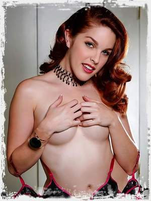 Horny redhead Amarna Miller fingers herself in black lingerie